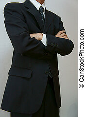 fold one's arms. Businessman crossing arms.