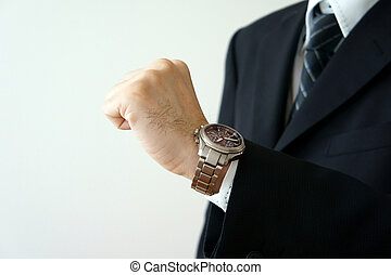 Wrist watch. Look at one's wrist for a watch.