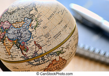 Globe East Asia (ballpoint pen and notebook). A globe is...