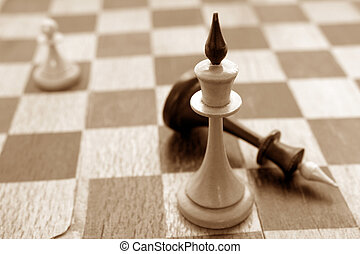 Old chessmen on the crackled chessboard background