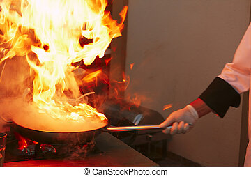 Professional kitchen: making sauce - Big fire, professional...