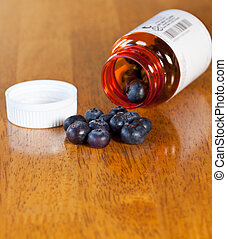 Blueberries in drug bottle