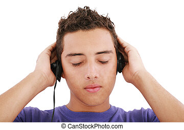 Boy listening to the music, isolated on white