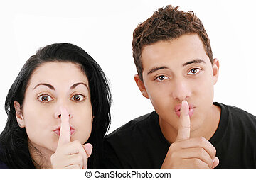 Friends or couple showing silence sign. Isolated on white