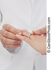 put on - close up view of humans hands wedding