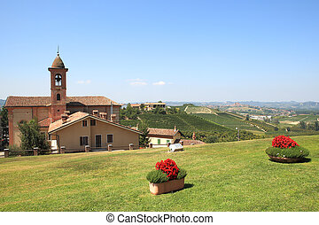 Small town of Grinzane Cavour, Italy. - View on old church...