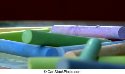 Colorful chalk, depth of field - Colorful sidewalk chalk...