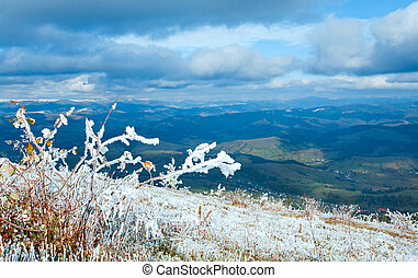First winter snow on autumn mountain plateau - October...