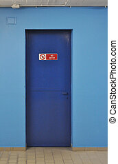 No entry sign on a blue firewall door
