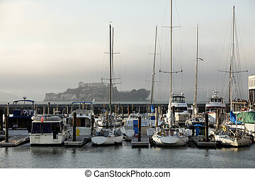 Alcatraz Federal Penitentiary on a background of yachts in...