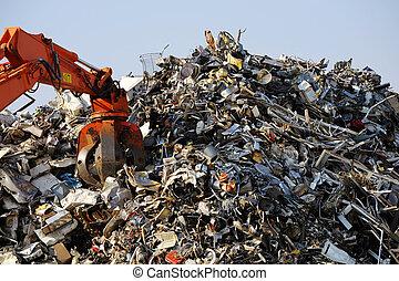 Scrap metal - Crane grabber loading rusty scrap metal for...