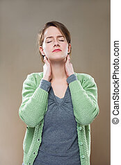 Neck pains - Portrait of beautiful young woman stressed out...