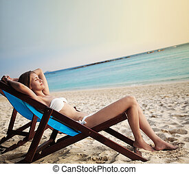 Beautiful woman in lounge on the beach. Phi phi island....