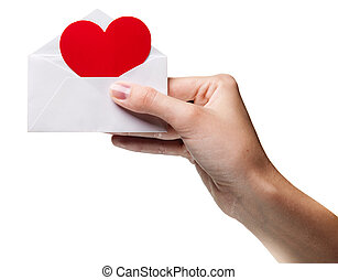 womans hand holding an envelope with a sign of the heart...