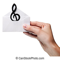 womans hand holding an envelope with a sign of the melody...