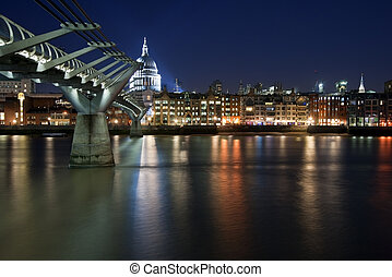 St Paul's Cathedral and Millennium Bridge in London at night...