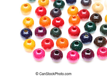 wooden beads - Colorful wooden beads on a white background