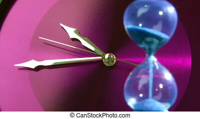 Purple clock and hourglass, closeup
