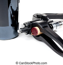 Red wine soaked cork in modern corkscrew - Cork from red...