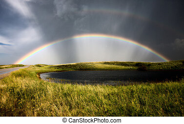 Saskatchewan Storm Rainbow overfield and slough pond hail