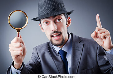 Detective and magnifying glass