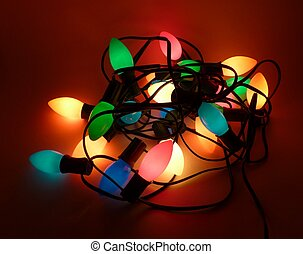Tangled Christmas lights - Colorful mess of tangled...