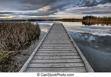 Crimson Lake Alberta Canada boat dock sunset