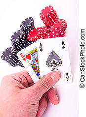 king of hearts and black jack with poker chips on white...