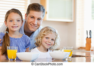 Father with his children in the kitchen