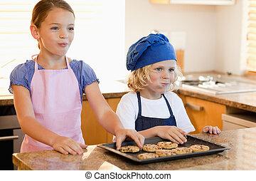 Siblings enjoying cookies together