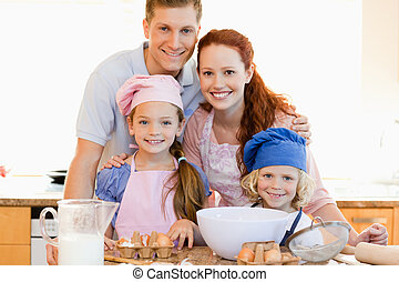 Family with baking ingredients in the kitchen