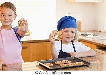 Siblings holding their cookies