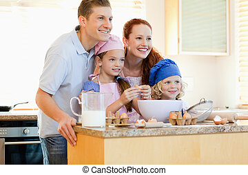 Family in the kitchen with baking ingredients