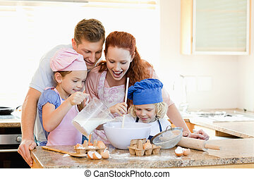 Family having a great time baking together - Happy family...