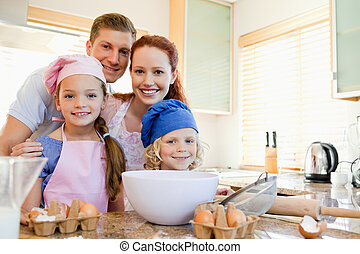 Cheerful family preparing dough - Cheerful happy family...
