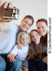 Digi cam being used to take family picture - Digi cam being...