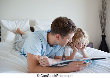 Father doing reading exercises with his son - Father doing...