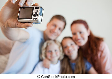 Digi cam being used to take picture - Digi cam being used to...