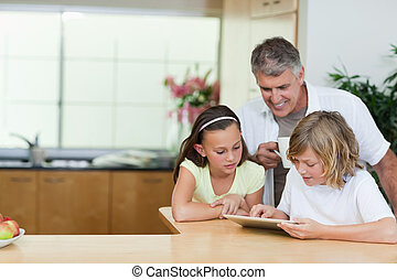 Father with children and tablet in the kitchen - Father...