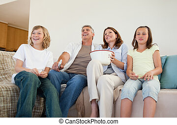 Family on the couch watching tv