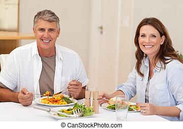 Smiling couple having dinner