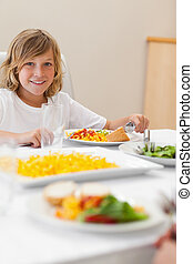 Boy sitting at dinner table