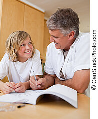 Male helping son with homework