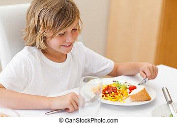 Boy eating dinner - Boy eating his dinner