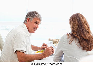 Couple talking during dinner