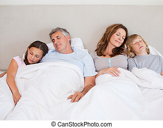 Family napping together