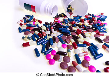 pills spilling out of container - colorful pills spilling...