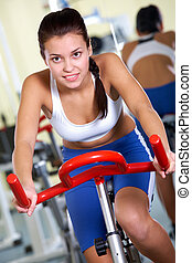 Training on sport equipment - Portrait of young female...