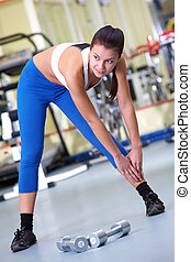 Training in gym - Photo of sporty brunette in sportswear...