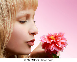 Beautiful girl with flower on pink background - Profile of...